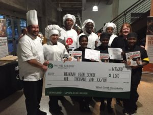"Wenonah High's seniors were awarded titles of Best Taste and Best Presentation and received autographed copies of television personality Alton Brown's cookbook ""EveryDayCook"" and the $1,000 prize for the academy. They worked in partnership with chefs from Wind Creek Hospitality. (Provided photo)"