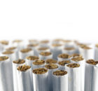 group of cigarettes against a white background, macro shot with selected focus and narrow depth of field