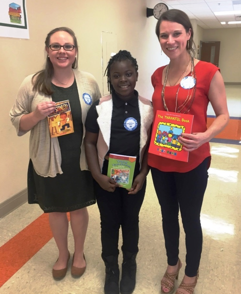 Birmingham Reads is an annual event in Birmingham City Schools. Volunteers read to classes and give each child a book to take home. (Allison Westlake/Alabama NewsCenter).