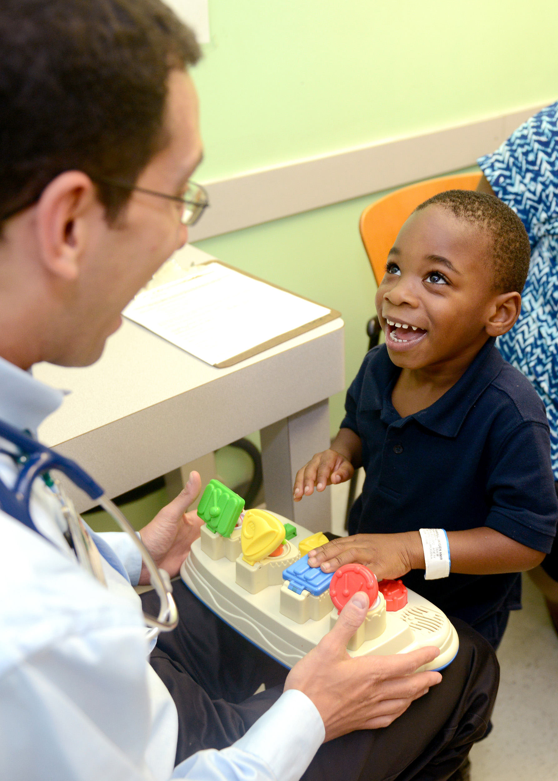 Dr. Justin Schwartz works with Jayden Harvill in one of the clinics at Children's of Alabama in Birmingham. (Denise McGill/Children's of Alabama).