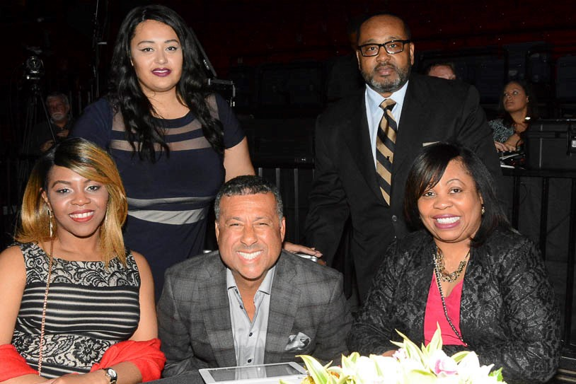 "Erskine ""Chuck"" Faush, Jr, (seated center) and the Barry Walker family during the Birmingham Fusion Awards at the Birmingham-Jefferson Convention Complex on May 5. (Stephonia Taylor McLinn photo)."