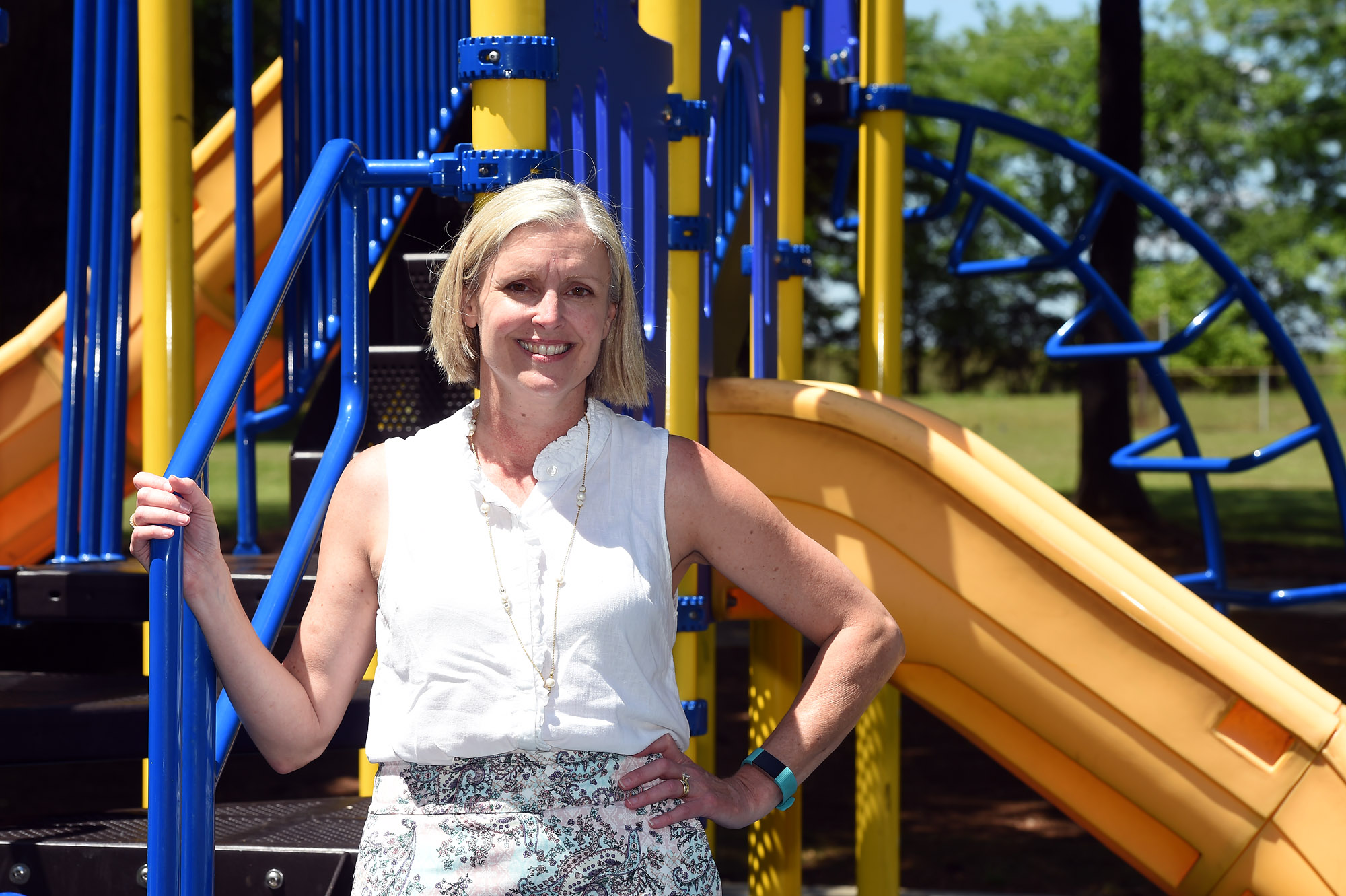 Dr. Susan Davies, associate professor in the Department of Health Behavior and a scientist in the UAB Center for the Study of Community Health and the UAB Center for the Advancement of Youth Health, poses at a playground near the UAB campus in Birmingham, Ala., Tuesday, April 25, 2017. (Photo by Mark Almond)
