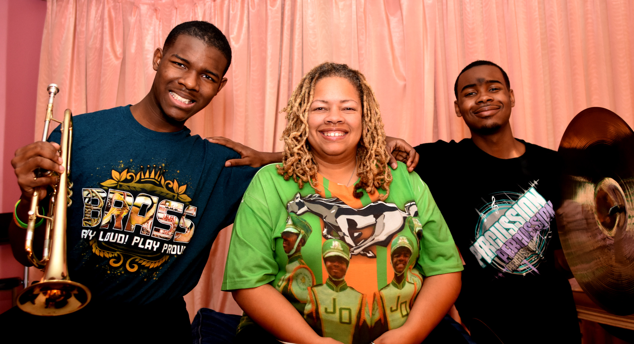Victoria Jackson is flanked by her sons Christian Jackson, left, and Victor Jackson. Christian is a junior and Victor a senior at Jackson-Olin High School and each is on the autism spectrum.