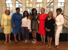 Huffman High's Taelor Allen and Imari Anderson, center are joined by  from left, Dr. Sharon Bell, Superintendent Dr. Lisa Herring, School Board Member Sandra Brown, School Board President Wardine Alexander and counselor Beverly Hackett. (Chanda Temple/For The Birmingham Times).