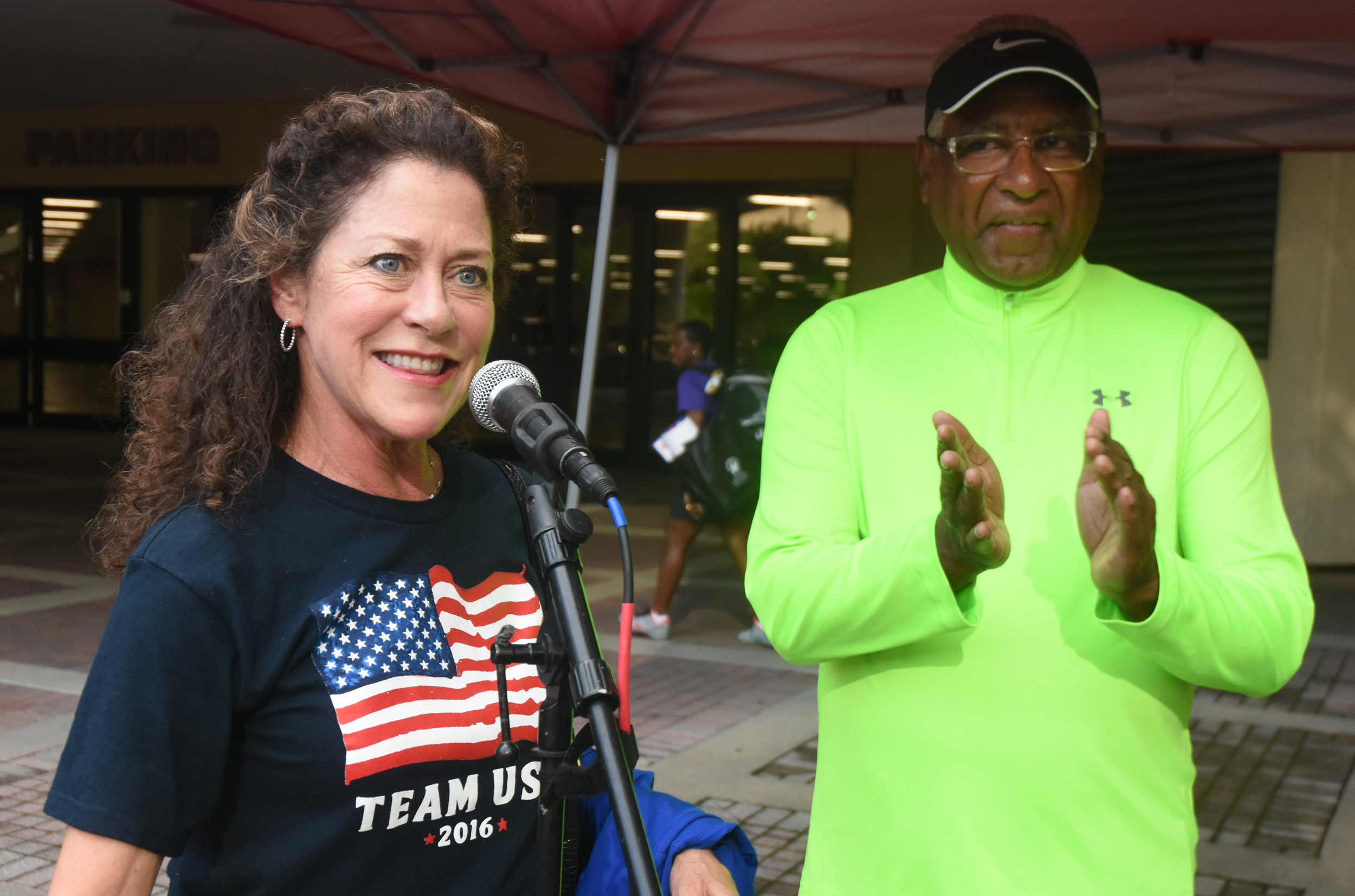 Jennifer Chandler Stevenson speaks at podium prior to the Mayor's Walk as Birmingham Mayor William Bell looks on. (Solomon Crenshaw Jr. photo)