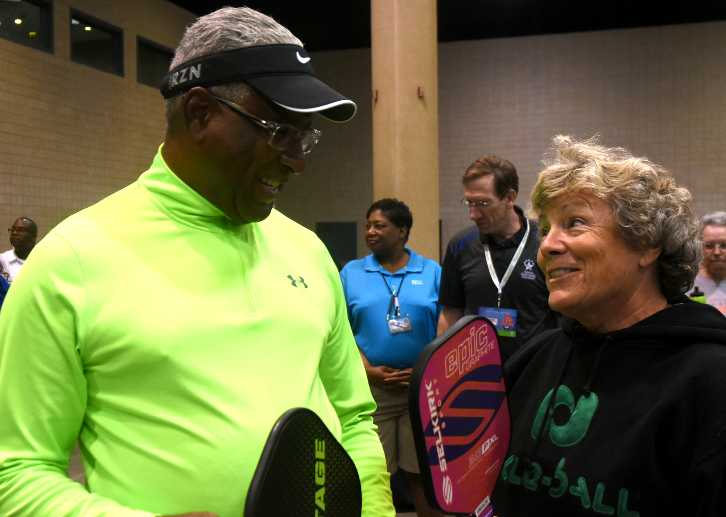 Birmingham Mayor William Bell gets instructions on the art of pickleball from Sharon MacKenzie. (Solomon Crenshaw Jr. photo)