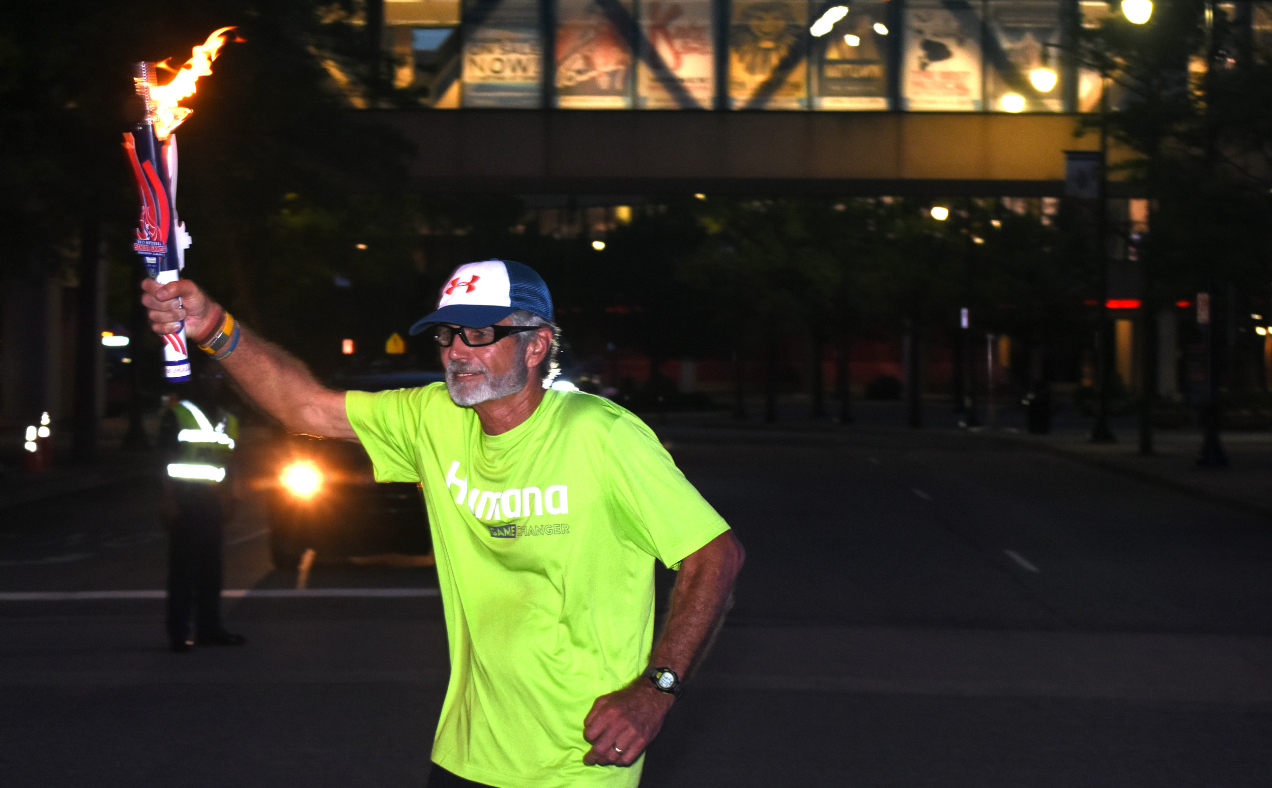 Jim Merritt runs the first leg of the torch run on Friday to signal the start of the 2017 Senior Games in Birmingham. (Solomon Crenshaw Jr. photo).