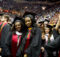 Graduates participate in commencement at the University of Maryland Graduation Ceremony. A Brookings' Economic Studies report found severe racial debt disparities for both black undergrads an those completing graduate college studies. (Jay Baker, Wikimedia Commons)